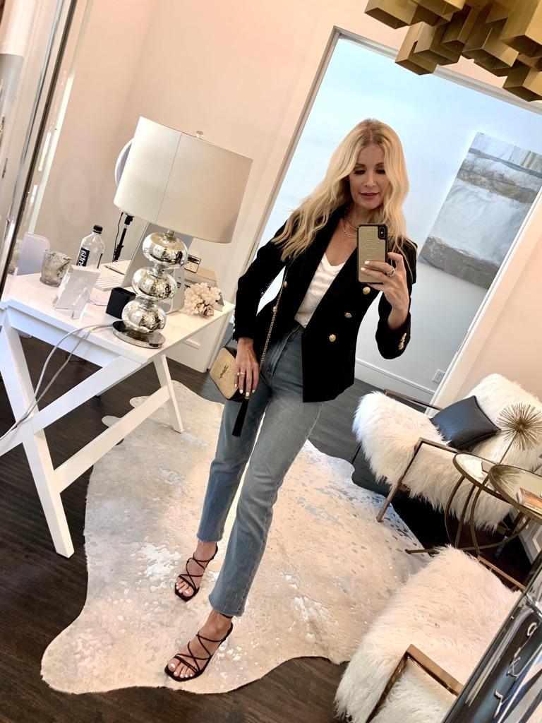 Dallas blogger wearing a black blazer and light wash denim