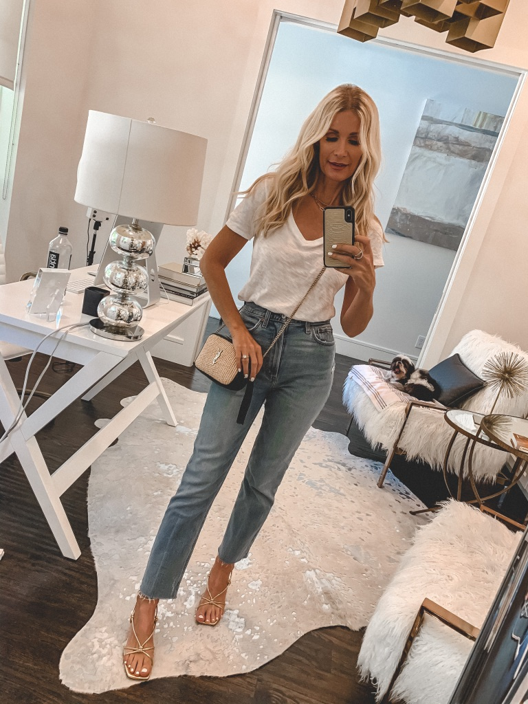 Dallas fashion blogger wearing light wash denim and a white tee