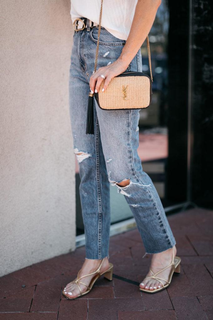 Dallas blogger waring ripped denim and a YSL handbag