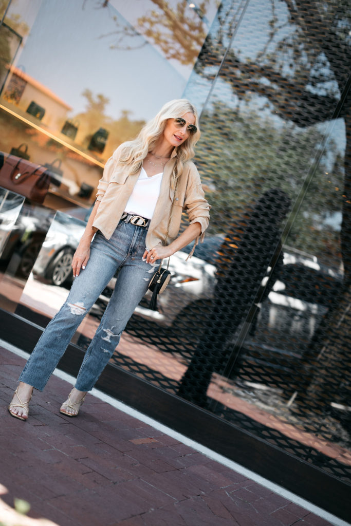 Fashion blogger wearing a neutral utility jacket and denim