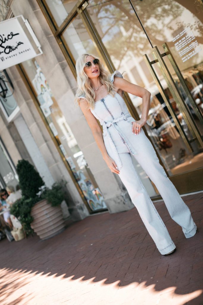 Dallas blogger wearing a light wash denim jumpsuit for fall