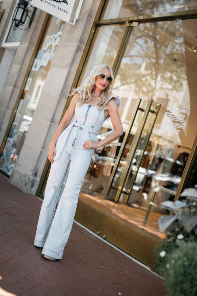 Fashion blogger wearing a denim jumpsuit for the fall and winter