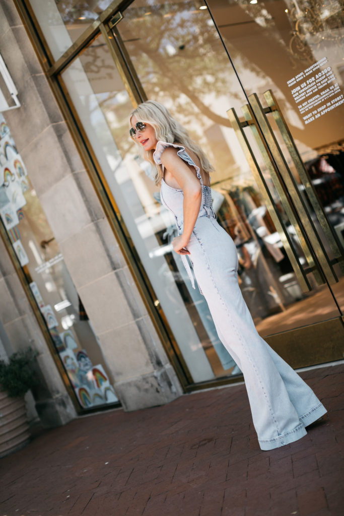 Dallas blogger wearing a flare denim jumpsuit by Alice and Olivia