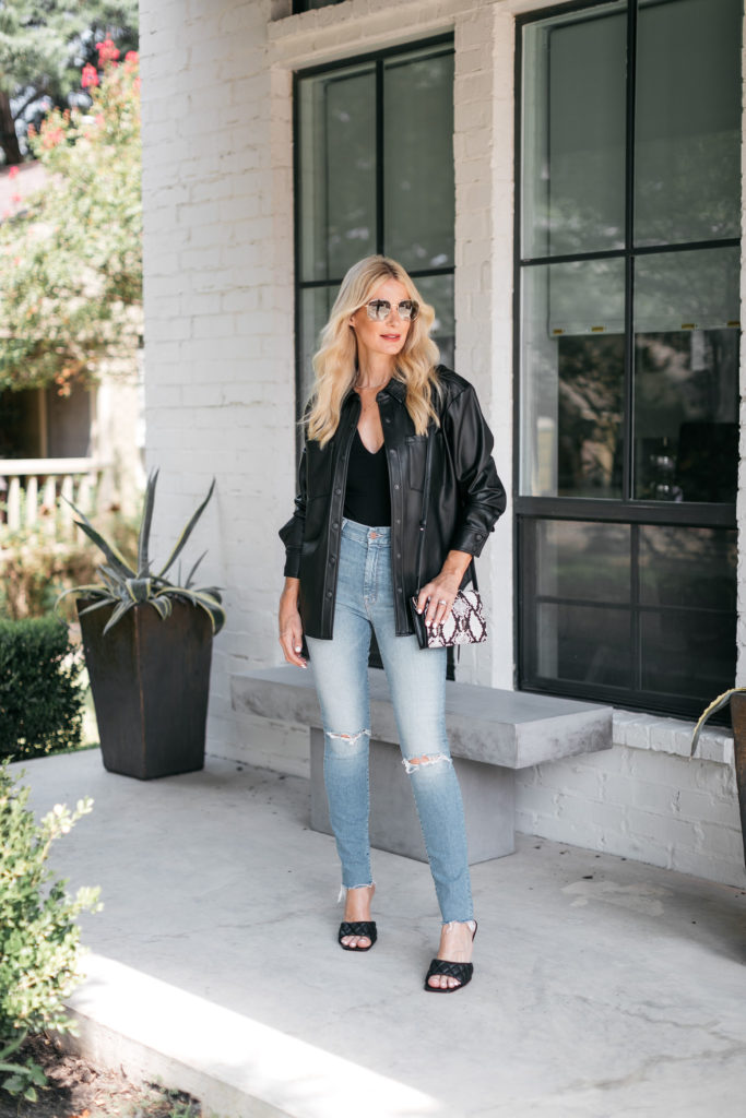 Dallas blogger wearing jeans and a jacket