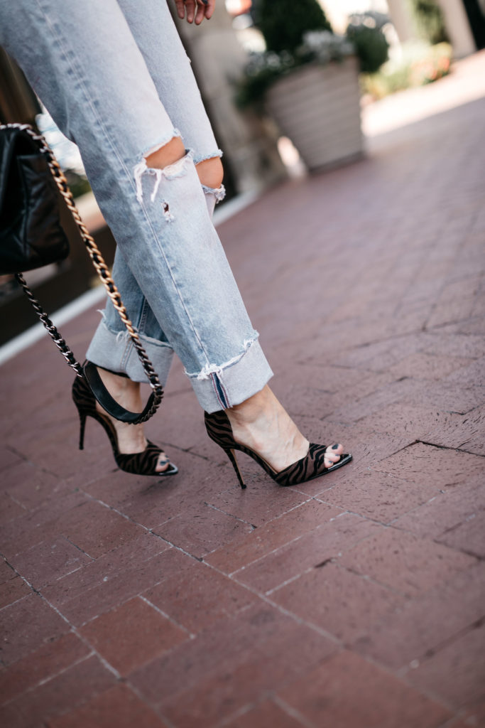 Dallas blogger wearing zebra heels and Moussy jeans