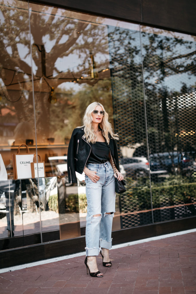 Dallas style blogger wearing a black leather jacket and baggy Moussy jeans
