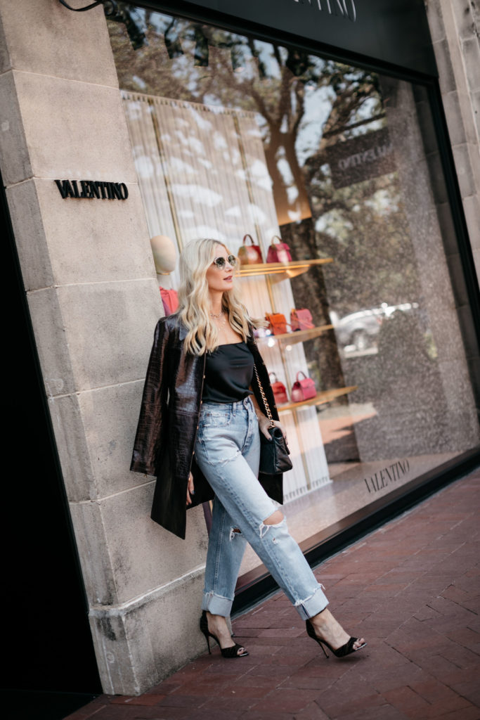 Dallas blogger wearing a strapless black top and a black leather coat