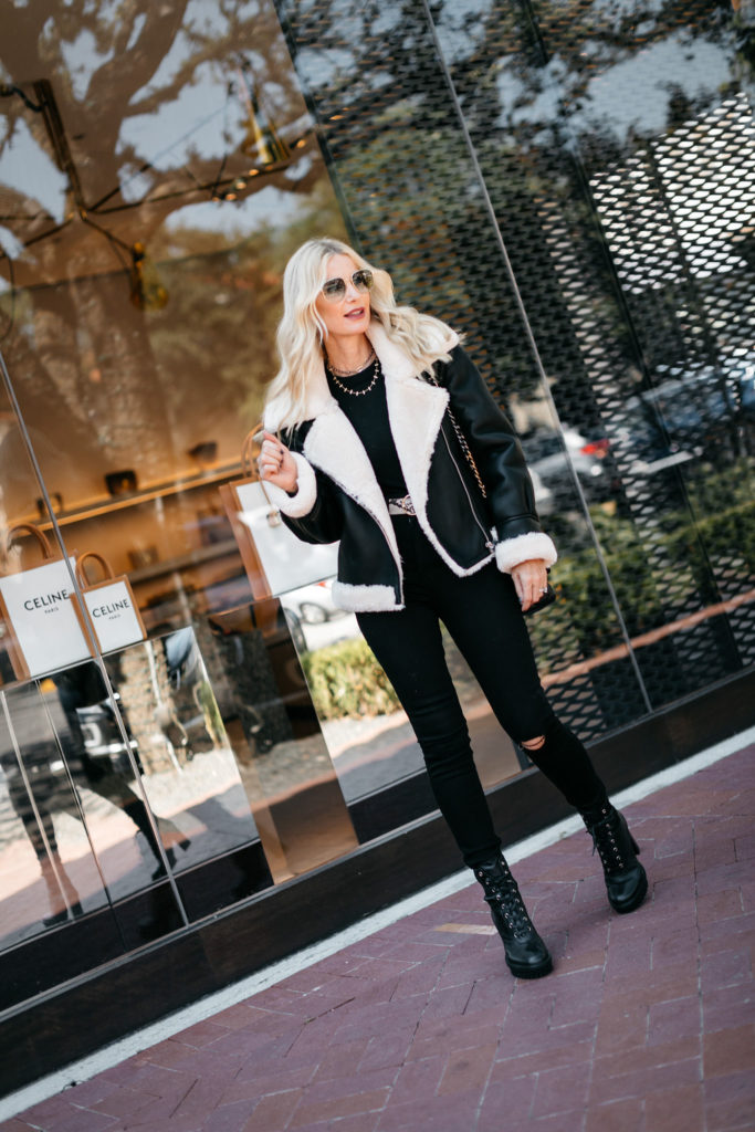 Dallas blogger wearing a shearling jacket and black combat boots from Nordstrom