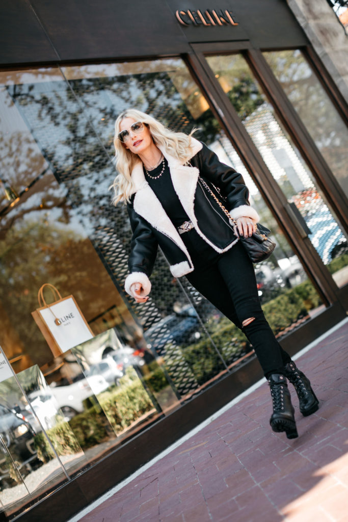 Style blogger wearing black denim and a black shearling jacket for winter