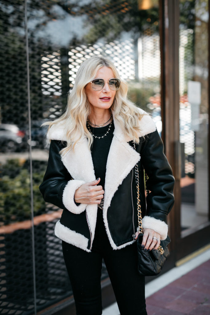 Dallas blogger wearing a shearling jacket from Nordstrom with black denim