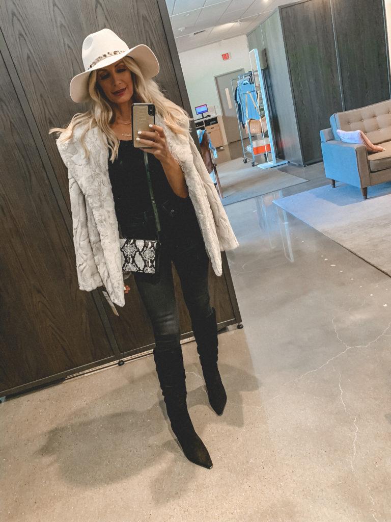 Dallas influencer wearing a fur coat and black denim