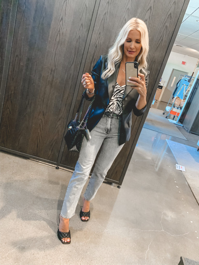 Dallas blogger wearing a black leather jacket and zebra tank