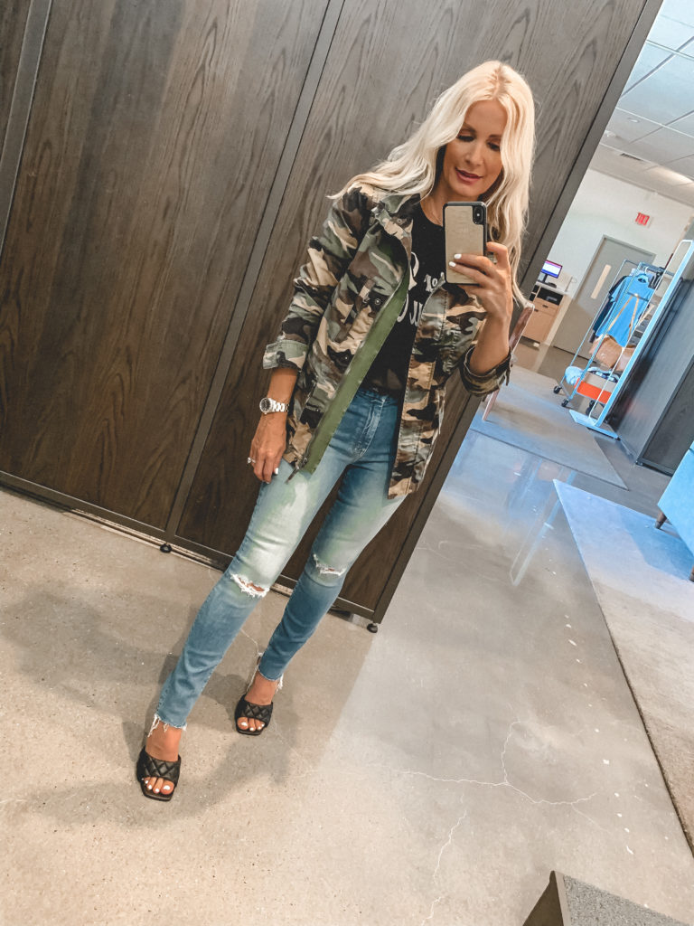 Dallas blogger wearing a camo jacket and light wash jeans