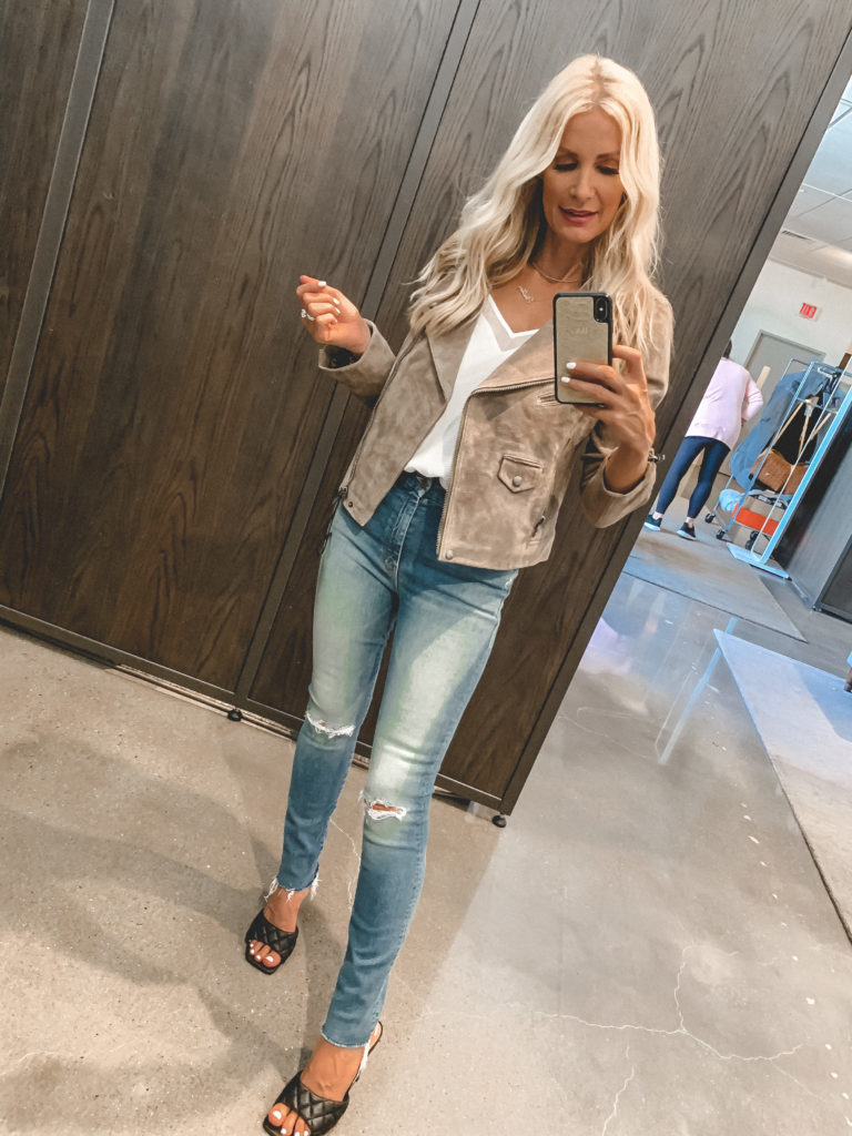Dallas fashion blogger wearing a neutral suede jacket and jeans