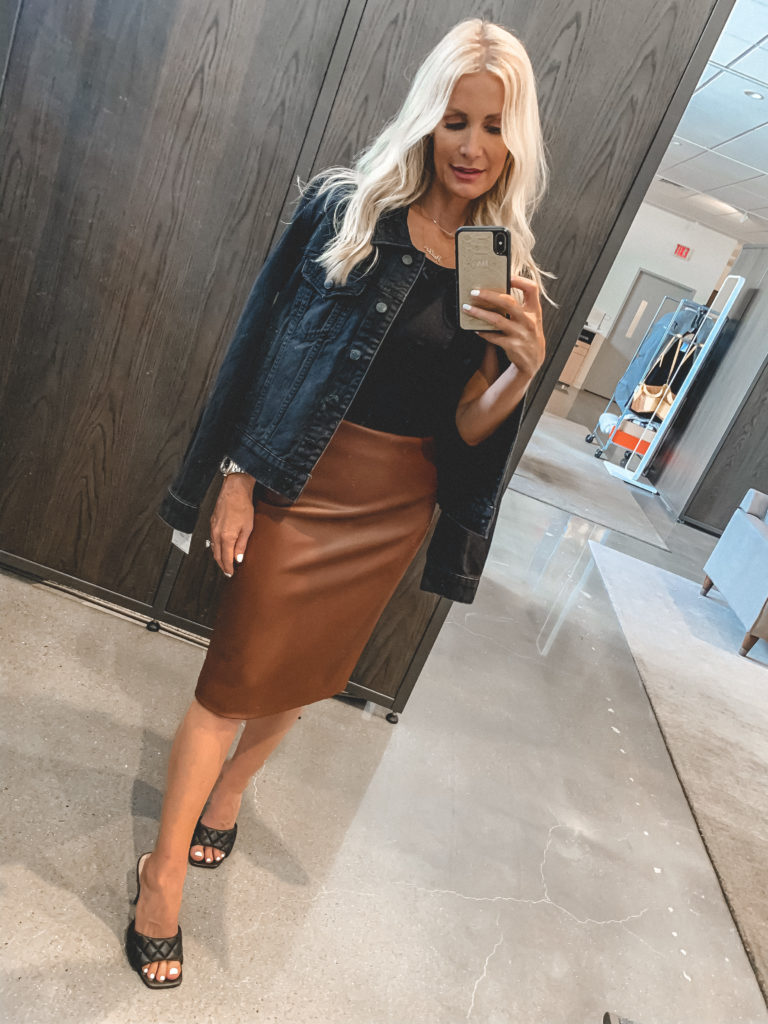 Dallas blogger wearing a brown leather midi skirt