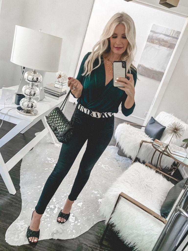 Dallas blogger wearing an emerald green bodysuit and black denim