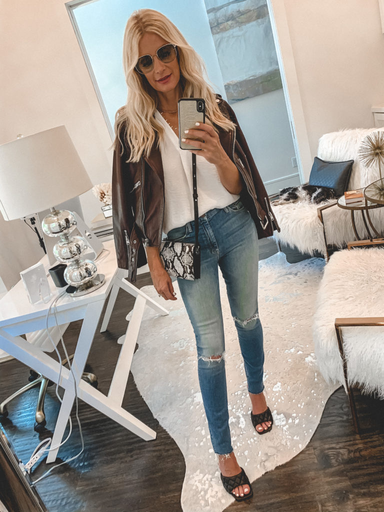 Style blogger wearing a leather jacket and ripped denim