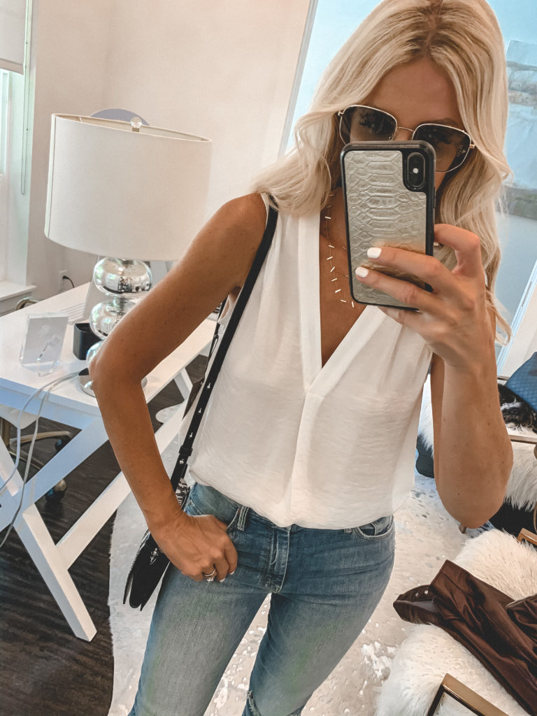 Dallas woman wearing a white top and jeans