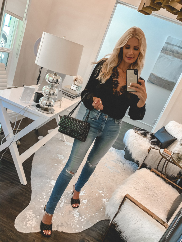 Dallas blogger wearing a black lace blouse and denim from NSALE