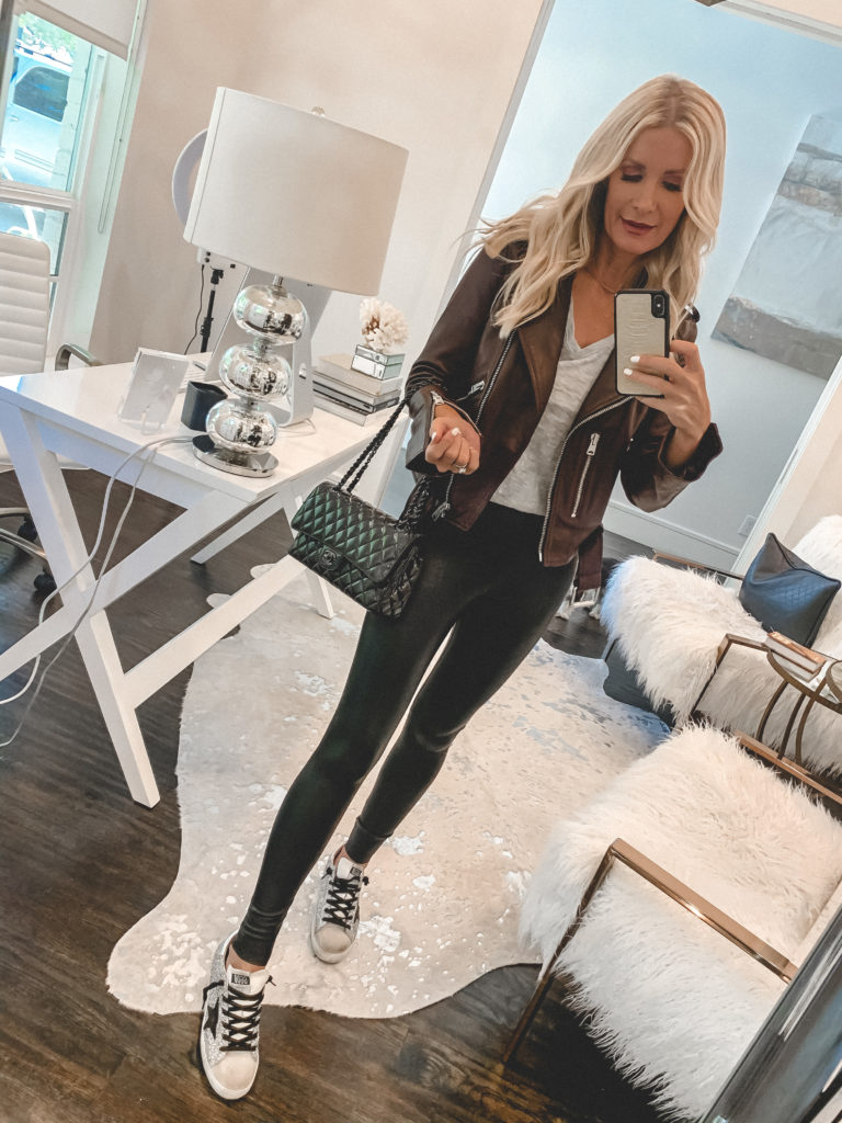 Dallas blogger wearing faux leather leggings