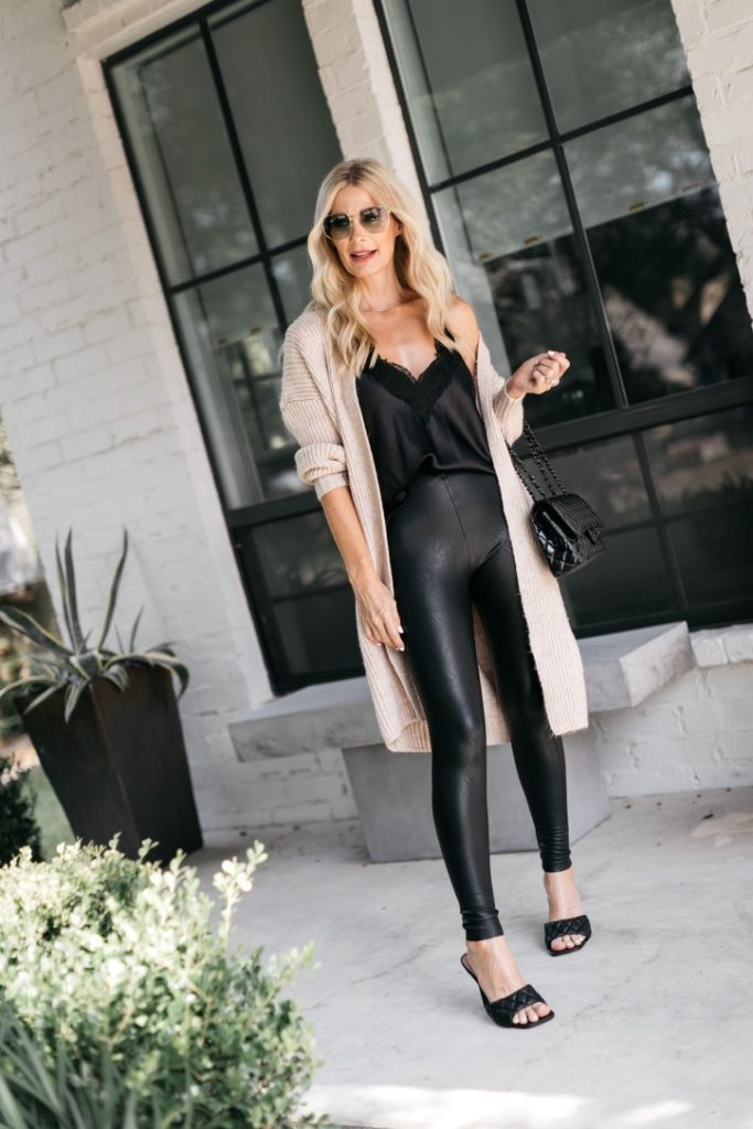 Dallas blogger wearing a neutral cardigan and a black lace tank with black heels
