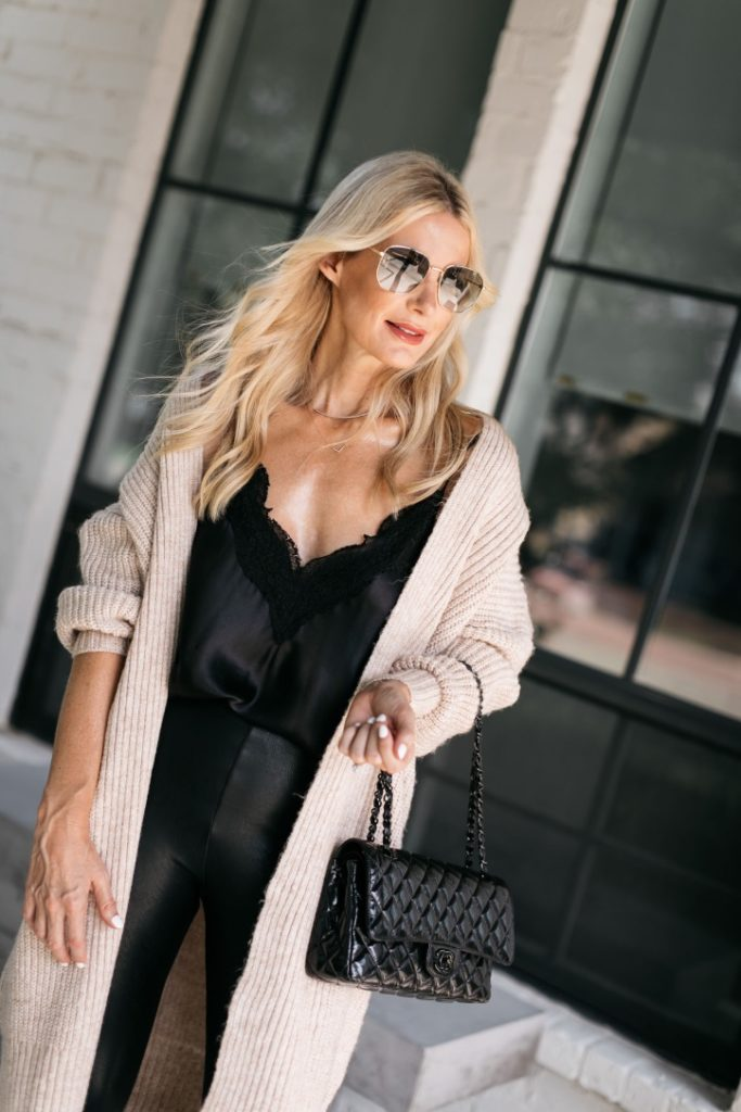 Style blogger wearing a neutral cardigan and leather leggings from the NSALE