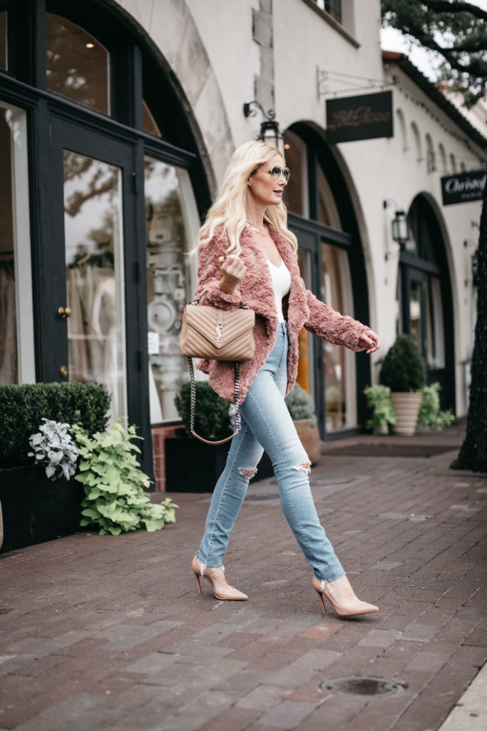 Dallas fashion blogger wearing a blush faux fur jacket and high waisted jeans