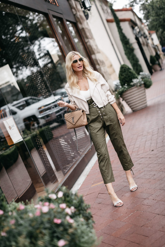 Dallas style blogger wearing paper bag pants and a white leather Moto jacket