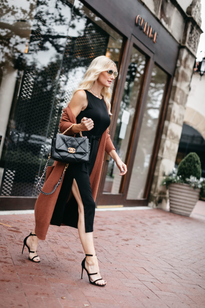 Fashion blogger wearing a little black dress and rust cardigan