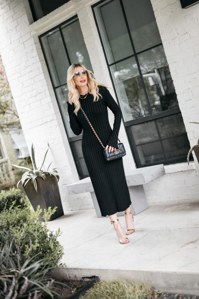 Dallas fashion blogger wearing a black ribbed midi dress and gold heels