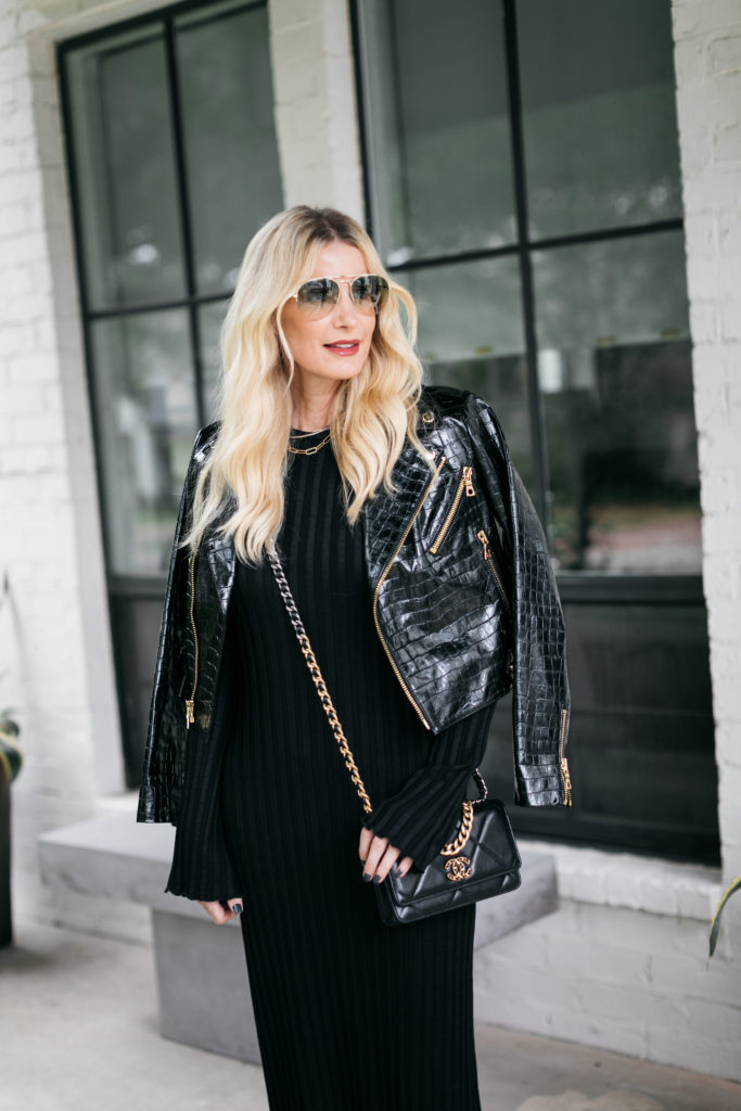 Dallas style blogger wearing a black dress and a black croc-embossed leather jacket for fall