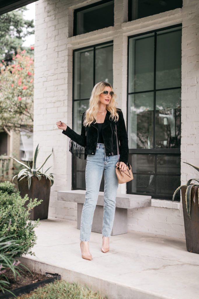 Dallas fashion blogger wearing a black fringe jacket and light wash denim for fall