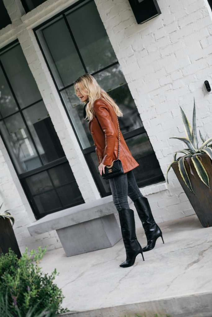Dallas fashion blogger wearing a brown leather jacket and black denim with tall boots | wearable fashion trends 2020