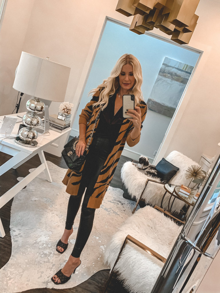 Dallas fashion blogger wearing a zebra cardigan and faux leather leggings