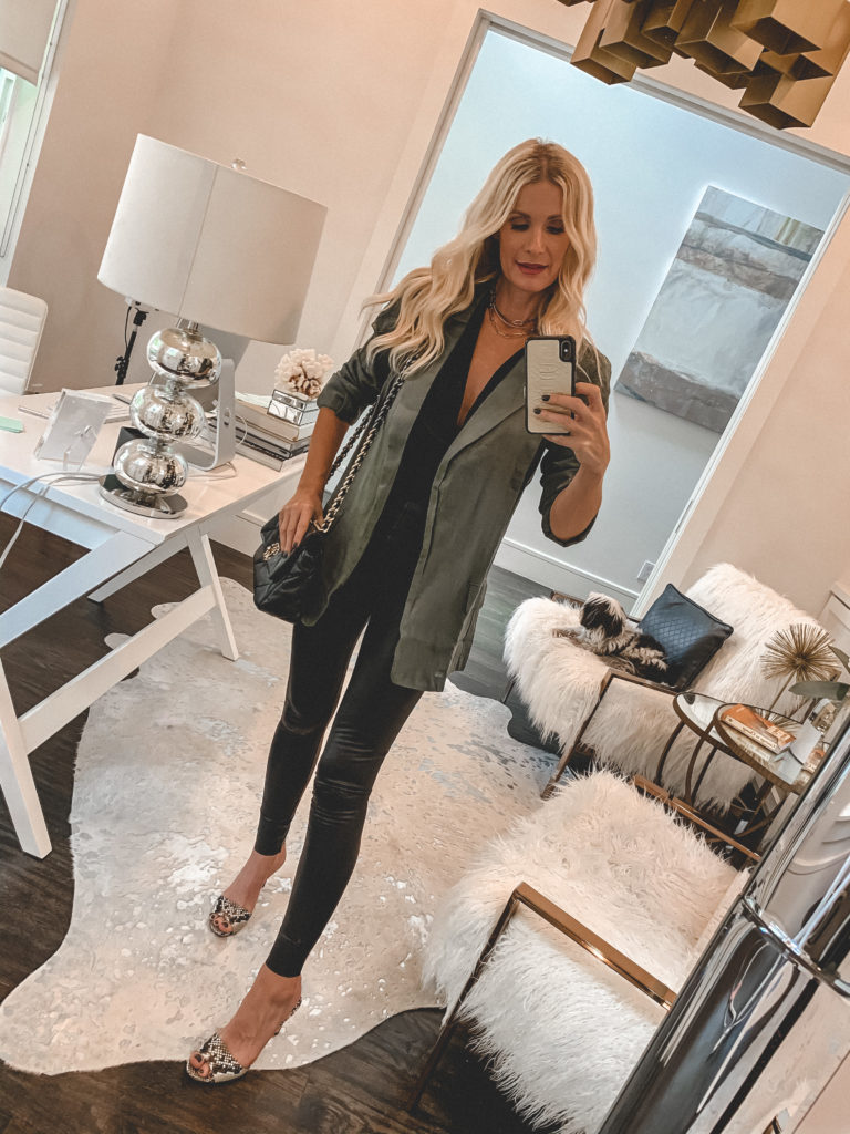 Dallas fashion blogger wearing a jacket and a black tank with leggings