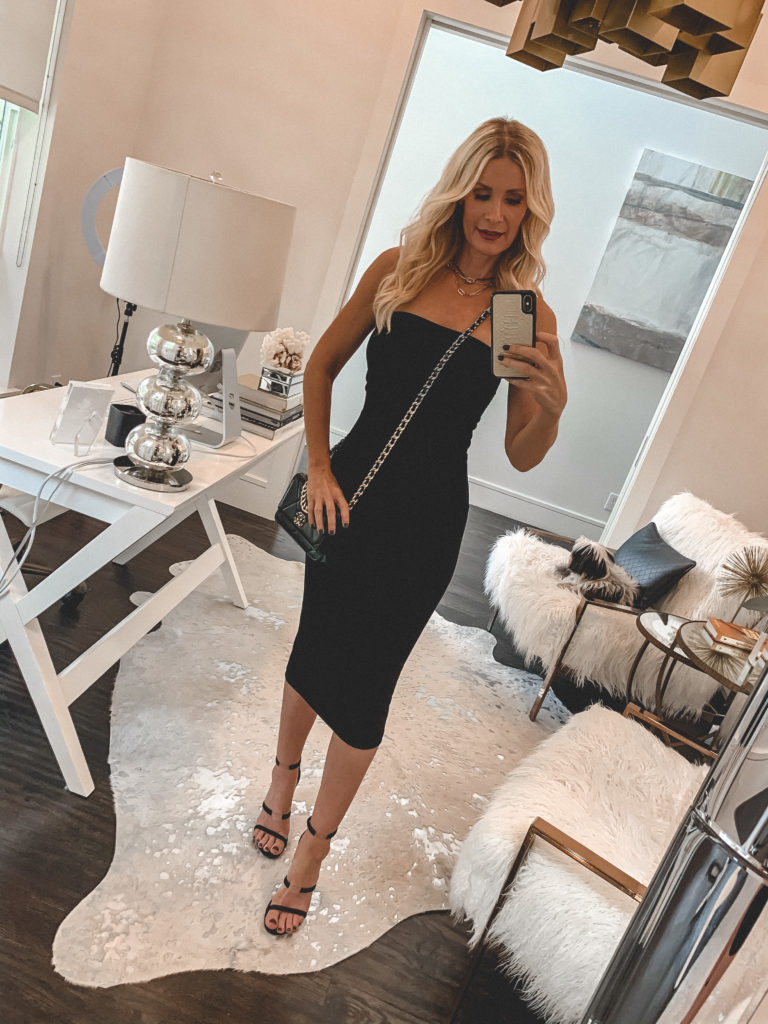 Dallas fashion blogger wearing a strapless little black dress and black heels