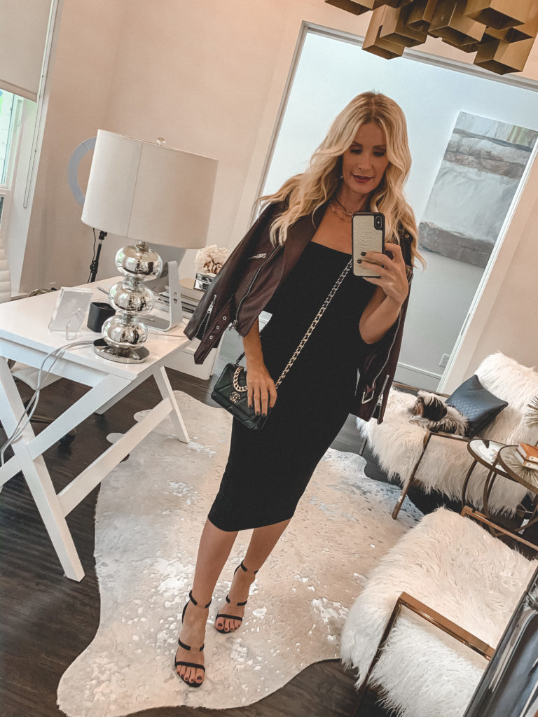 Dallas blogger wearing a black slip dress and a burgundy leather jacket