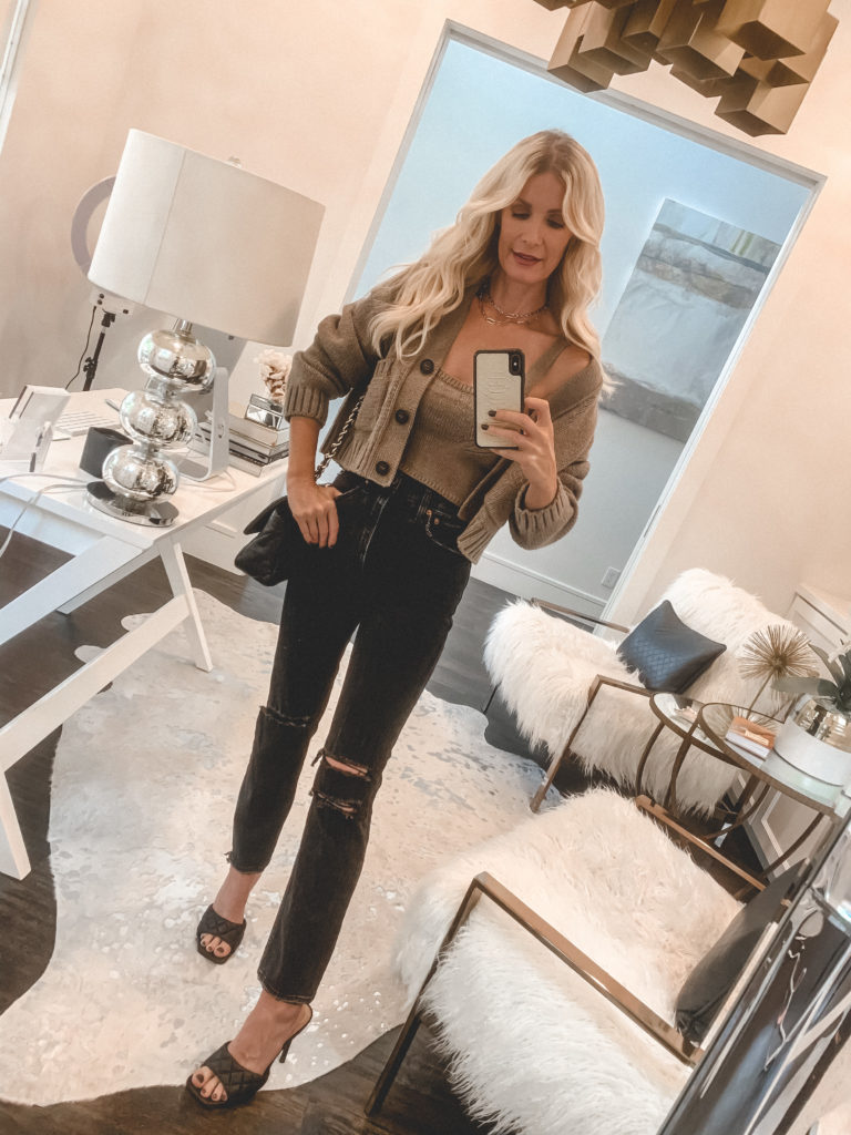 Dallas blogger wearing a cashmere sweater and crop top set and black denim