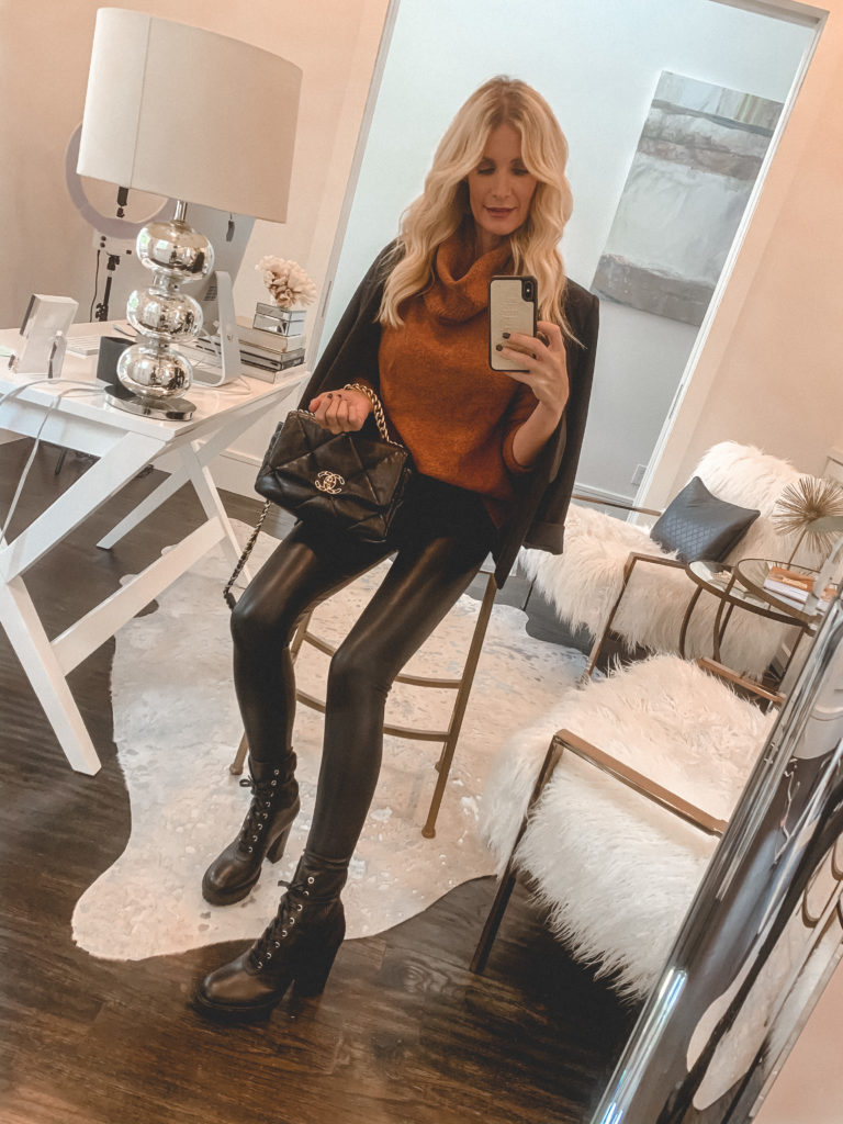 Fashion blogger wearing a rust turtleneck sweater and faux leather pants