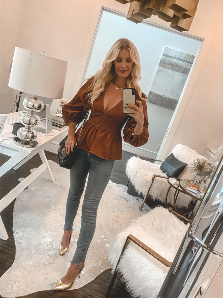 Dallas blogger wearing a rust puff sleeve top and denim