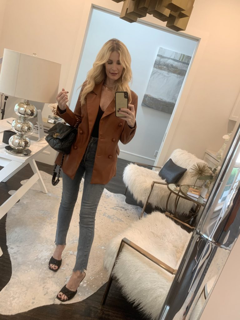 Dallas fashion blogger wearing a rust leather jacket and ankle length denim