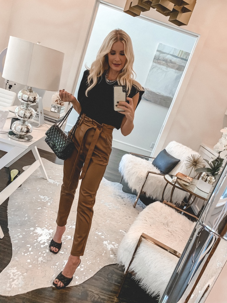 Dallas fashion blogger wearing faux leather pants and a black top