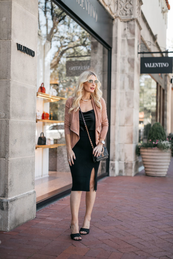 Dallas blogger wearing a suede jacket and a black slip dress