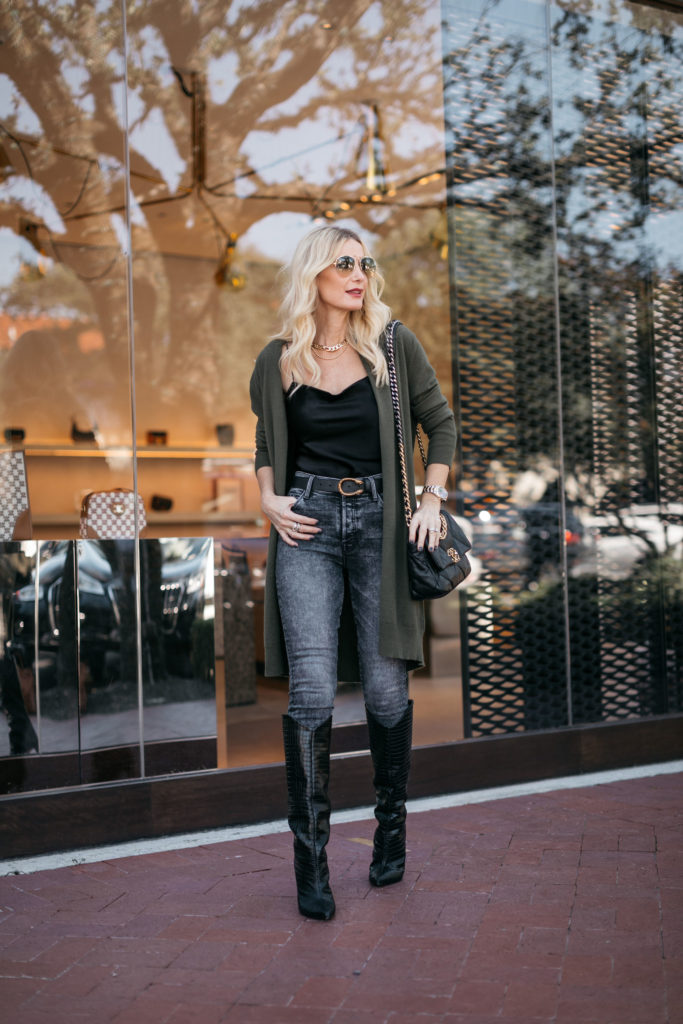 Dallas style blogger wearing a long olive green cardigan and a black bodysuit for fall