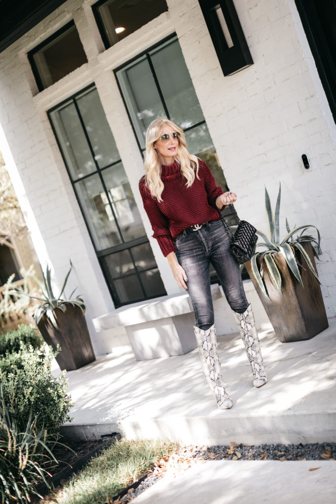 Dallas style blogger wearing a burgundy sweater and tall snake print boots