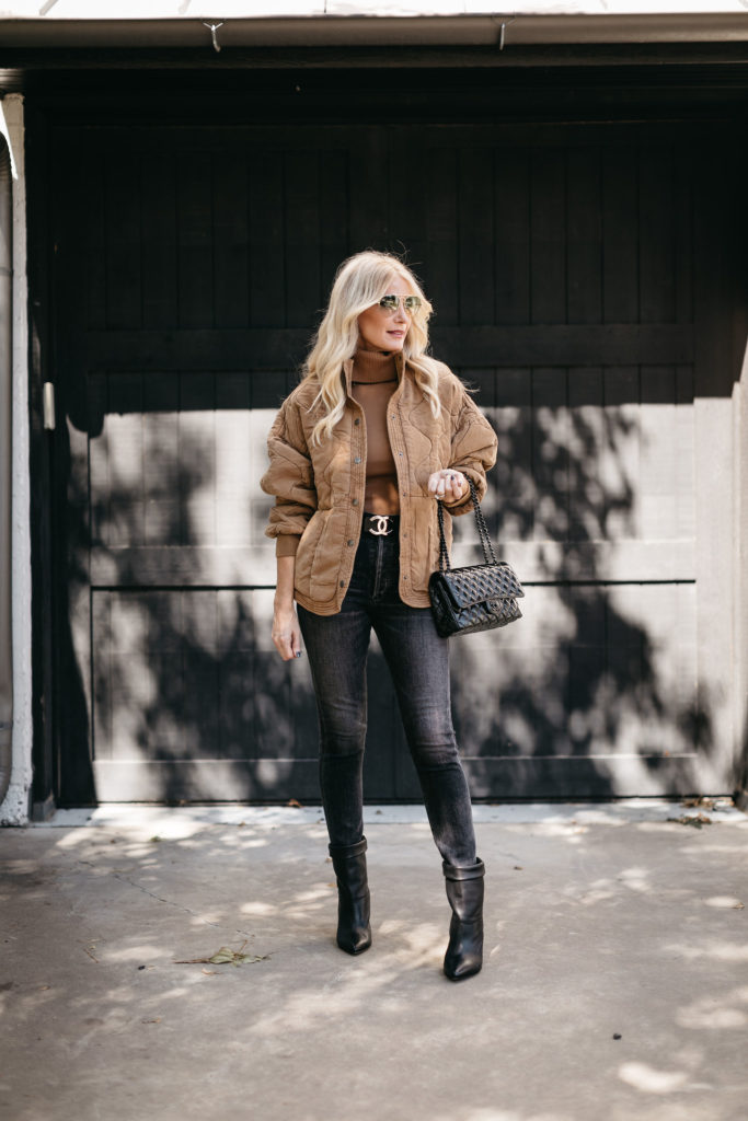 Dallas style blogger wearing a tan colored jacket and black denim in the fall