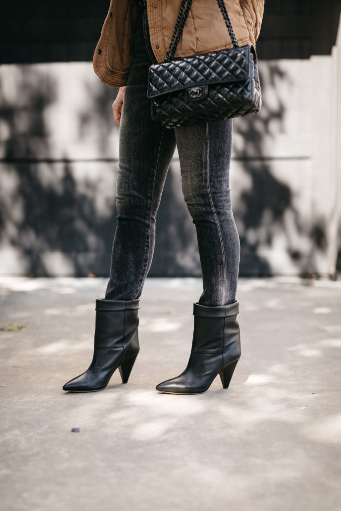 Fashion blogger wearing black ankle bootes and black denim for fall and winter 2020