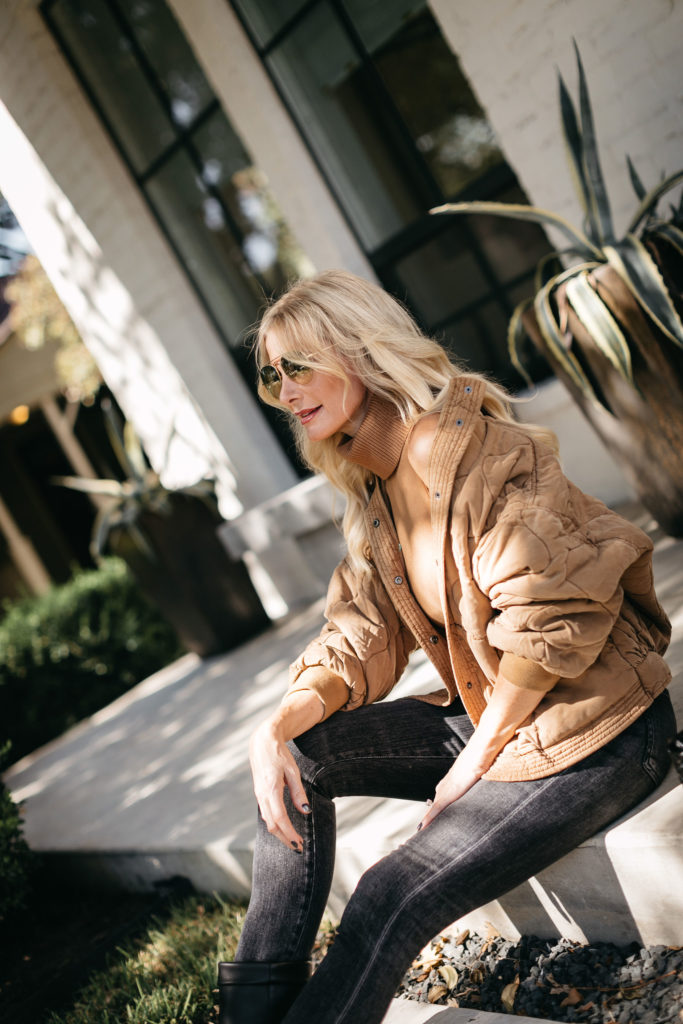 Fashion blogger wearing a neutral fall jacket and a neutral turtleneck sweater