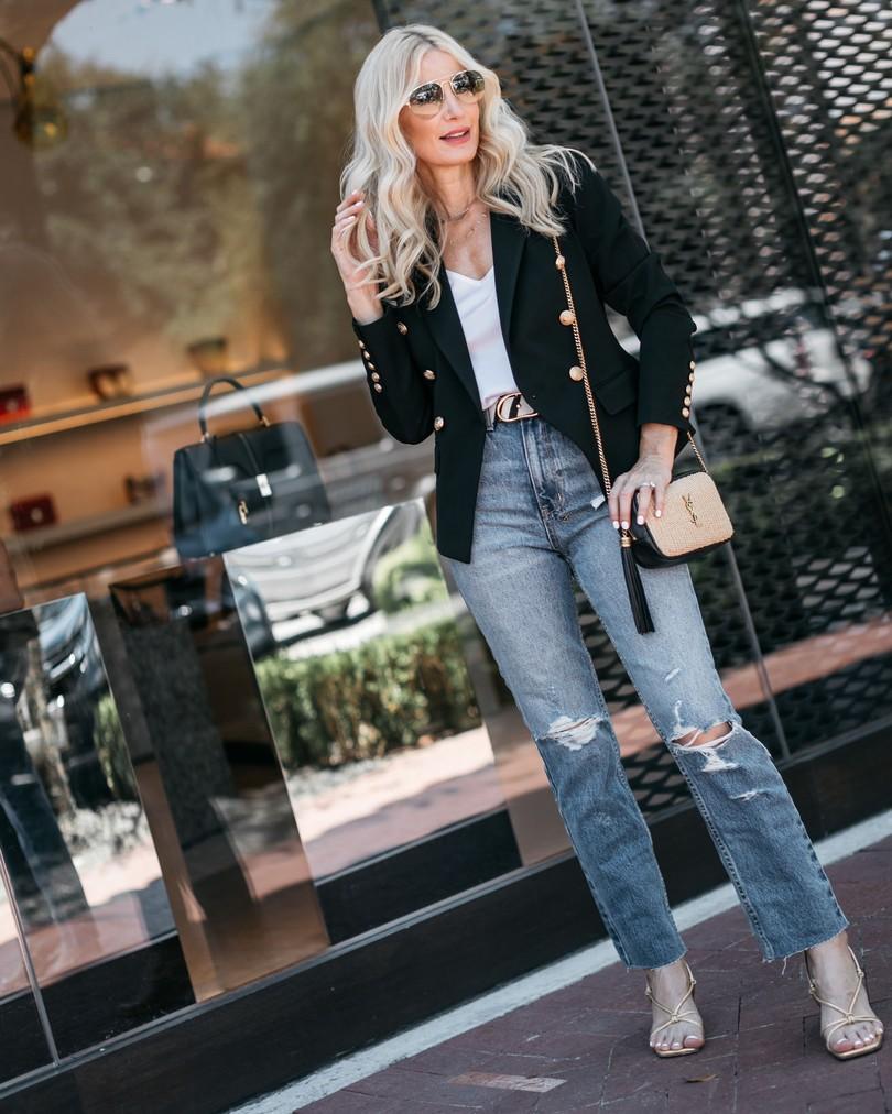 Dallas fashion blogger wearing a black blazer and ripped denim