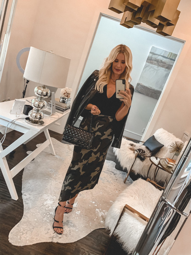 Dallas fashion blogger wearing a camo midi skirt and a black leather Moto jacket